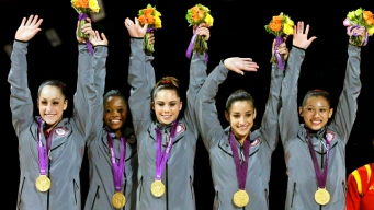 Women's Gymnastics Team Strikes Gold