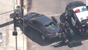 Injured Woman Pulled From Pursuit Vehicle at Trader Joe's