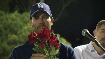 Borderline Shooting: 12 Red Roses Express a Father's Grief