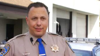 CHP Officer Saves Life of Woman About to Jump the Freeway