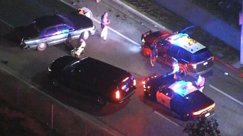 Officers Pursue Maroon Dodge Dart Along 210 Freeway