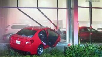 Subaru Driver Crashes Into a $150,000 BMW in Dealership Showroom