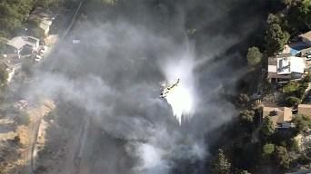 Firefighters Protect Hillside Homes From Tujunga Brush Fire