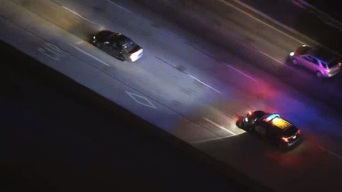 Police Pursuit Travels on 405 Freeway Northbound to 5 Freeway