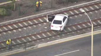 Driver Stops on Metro Expo Line Tracks