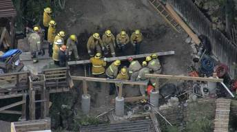 Firefighters Rescue Worker Pinned Under Block Wall