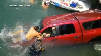 Lifeguards Rescue Couple Trapped in a Submerged Car in Long Beach