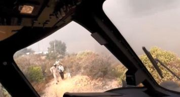 Watch: LAFD Helicopter Pilots Rescue Three People, Dogs as Woolsey Fire Approaches