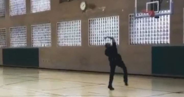 LAPD Officer Arius George nailed a stunning trick shot in this video posted Monday April 23, 2018 to the LAPD's Twitter page.