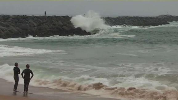 Waves Pound Beachgoers At Newport Beach
