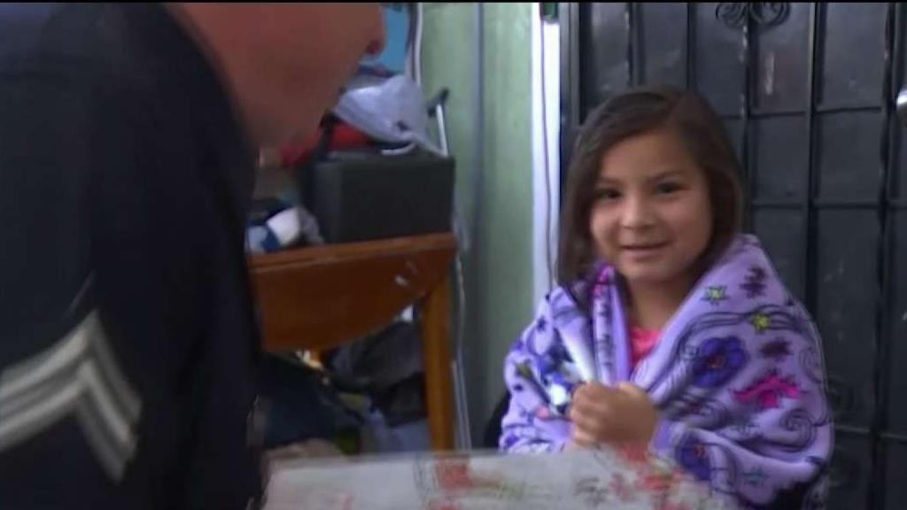 6-Year-Old Emily Ramirez, who was shot in the back two months earlier, gets swarmed with Christmas presents.