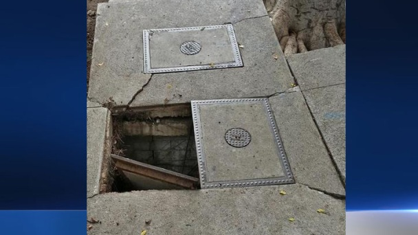 Gaping Hole in LA Sidewalk Temporarily Patched Up