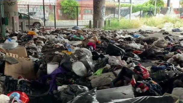 Tons of Garbage Pose Health Hazard in Fashion District