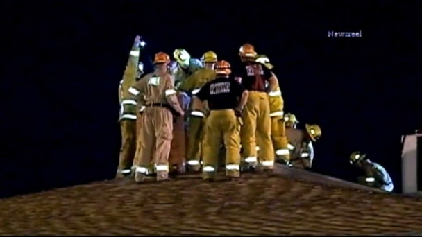 Firefighters Rescue Soot-Covered Man Stuck in Chimney