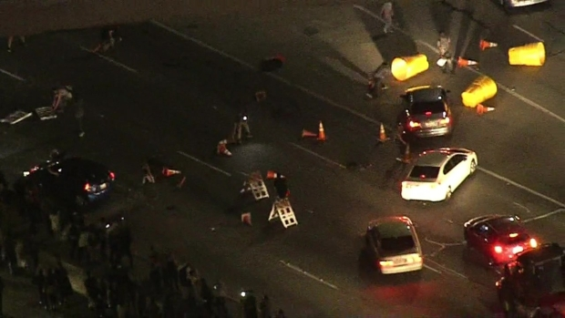 [LA] 101 Shut Down as Protesters Flood Lanes, Throw Barrels