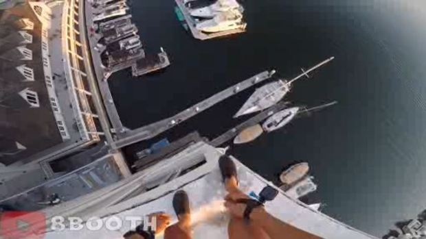 Man Films Daring Jump Into Harbor
