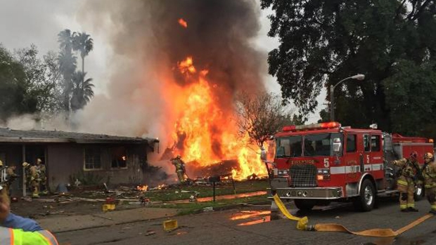 A least 1 dead after small plane crashes into a California home