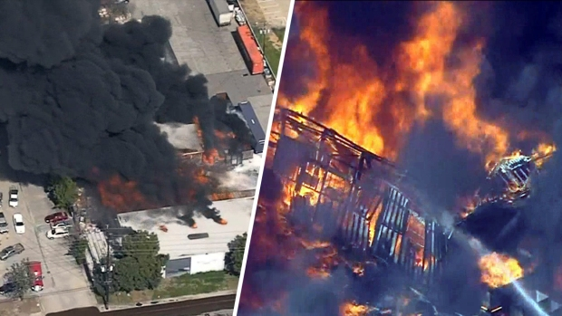 Fire breaks out at warehouse in Santa Fe Springs after vehicle crash