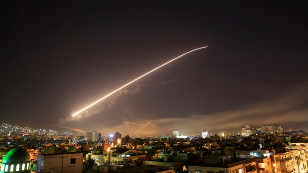 [NATL] In Photos: Syria Rocked by Military Strikes