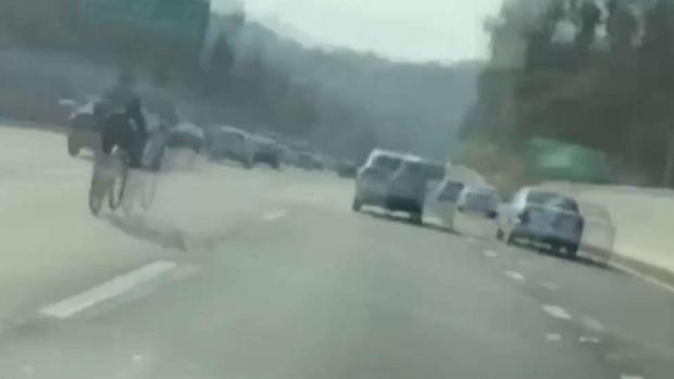 [LA] Video Captures Man Biking on Freeway