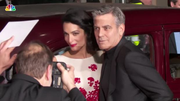 George Clooney threatens prosecution over baby photos