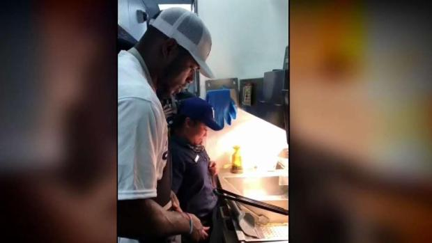 Dodgers' Yasiel Puig Takes Orders at McDonald's