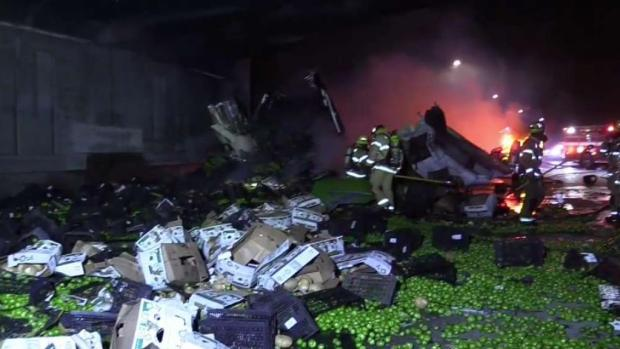 Driver Rescued in Fiery Produce Truck Crash