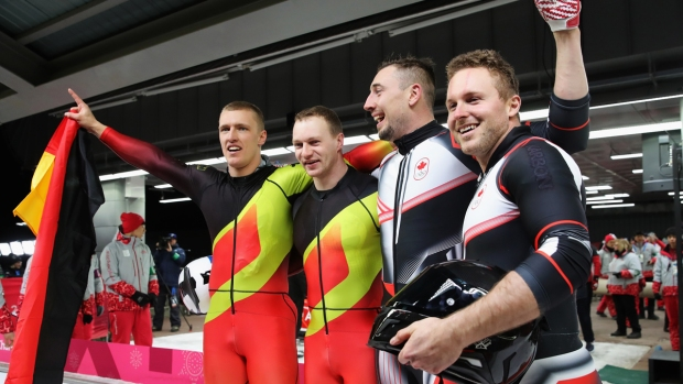Feb. 19 Olympics Photos: Germany, Canada Tie for Bobsled Win