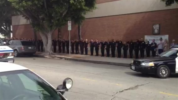 [LA] Colleagues Salute as LAPD Officer's Body Arrives at Hollywood Station