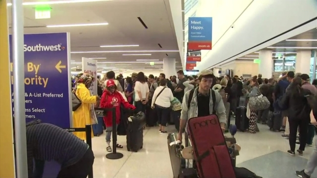 [LA] Crowd of Passengers Wait to Be Re-Screened at LAX