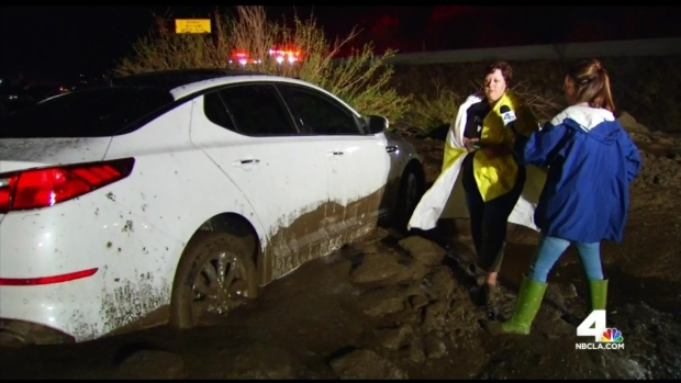 Mud Flow Covers Roadway, Stranding Cars
