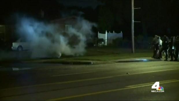 Tear Gas, Arrests Amid Turmoil Over Killing of Teen