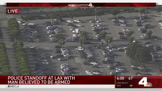 [LA] Police in Armed Standoff at LAX Parking Lot