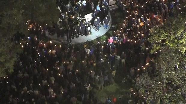 From the Sky Hundreds Gather for Fallen Officer's Vigil