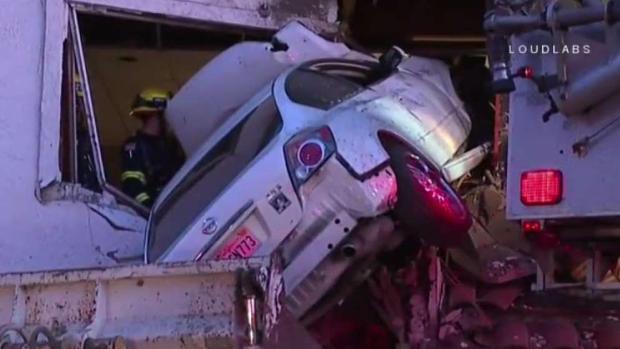 Surveillance Video Captures Car Crash Into Second Floor of Building