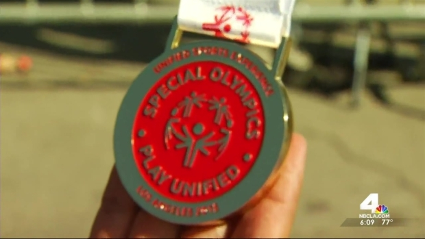 [LA] Triathlete Gets First Gold at Special Olympics