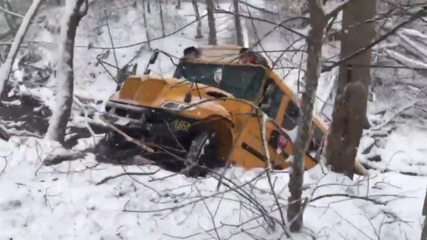 [NATL-DC] Raw Video: School Bus Slides Into Creek Amid Snowy Conditions