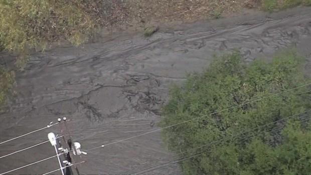 [LA] Watch: Waves of Mud Crash Down Burbank Street