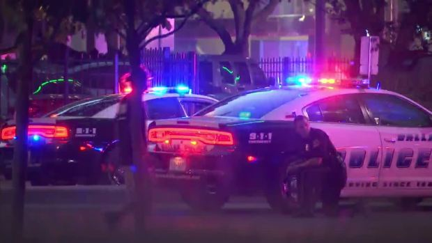 [NATL-DFW] Raw Video: Officers Take Cover After Shots Fired Downtown
