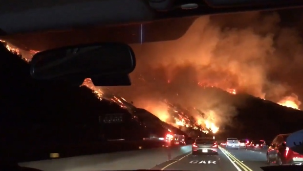 [NATL] LA Drivers Pass Raging Wildfire During AM Commute