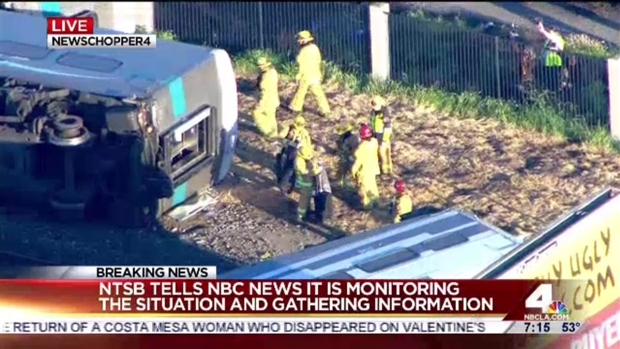 RAW: 3 Derailed Train Cars After Truck Crash