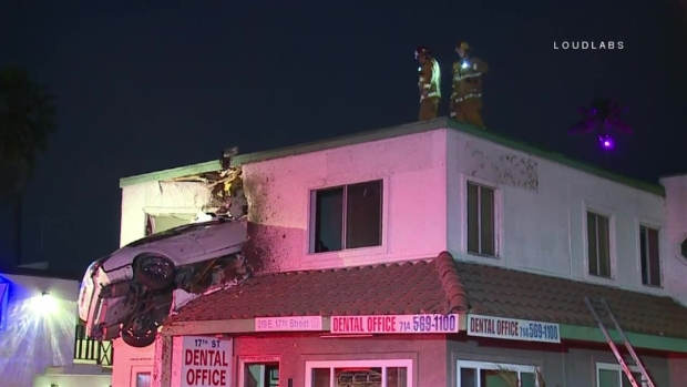 [LA -- STRINGER] Speeding Car Soars Into Second Story of Building