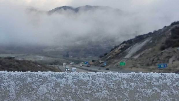 Blizzard-Like Conditions Make for Icy Grapevine Drive