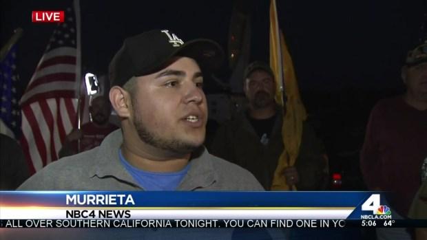 [LA] Crowd Gathers Overnight Ahead of Immigrants' Arrival