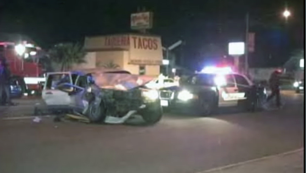 Police Cruiser Crashes into Car, Killing Two