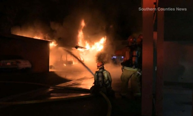 [LA] Fire Rips Through Orange Carport