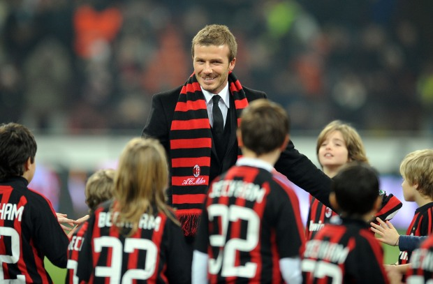 Beckham Changes Stripes, Posh Stays With Basic Black