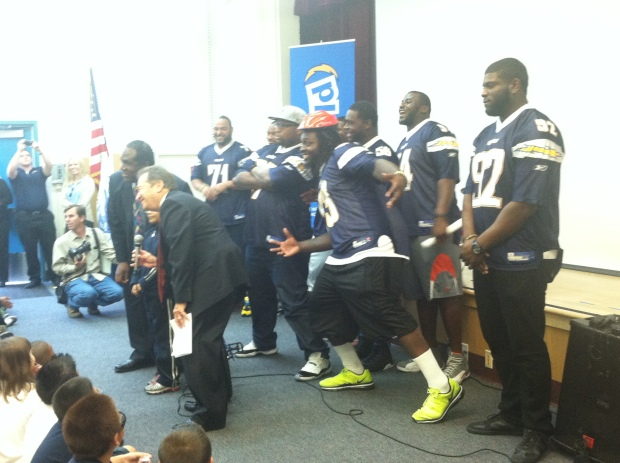 Chargers Surprise Students with 200 Bikes