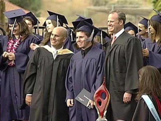 [LA] The Graduate Wears Two Caps, Gowns
