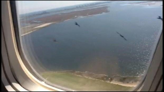 [LA] Raw Video: Birds Crash Into Flight 1063 (Slo-Mo)